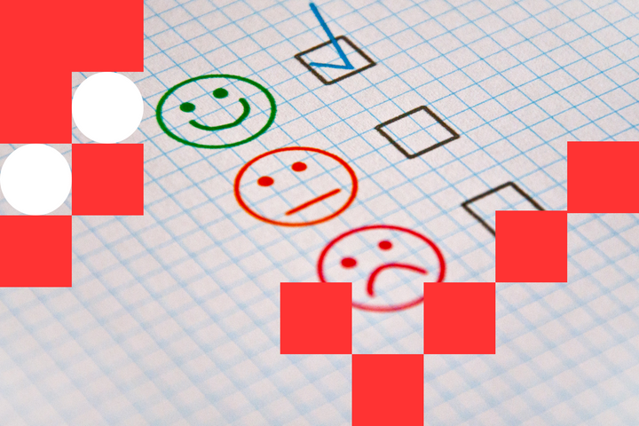 Three smiley faces (happy, indifferent, and sad) drawn on a piece of paper with checkboxes next to them. A tick is put in the happy face box as the approval of the 5-star rating of the app.